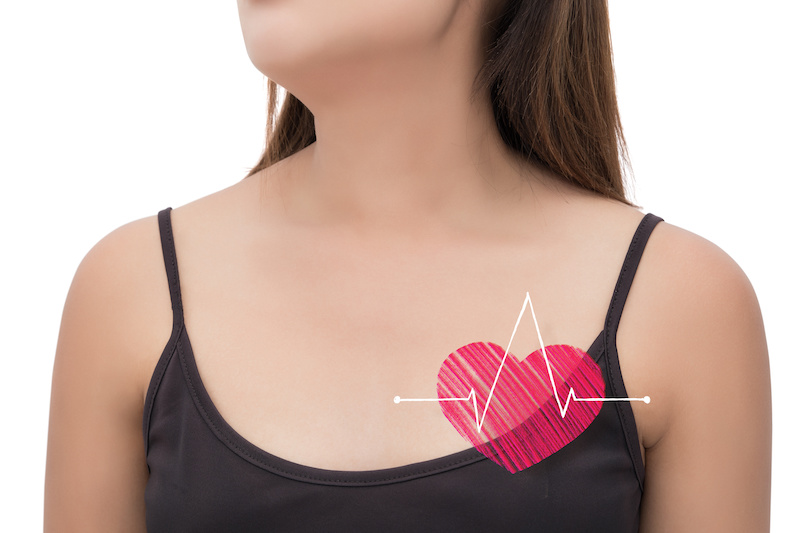 Beautiful woman is clutching her chest. Heart disease. Acute pain possible heart attack.; Blog: Myths About Women's Heart Health