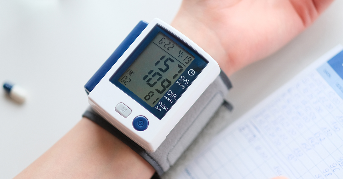 Hypertension. Patient measuring blood pressure; blog: understanding blood pressure