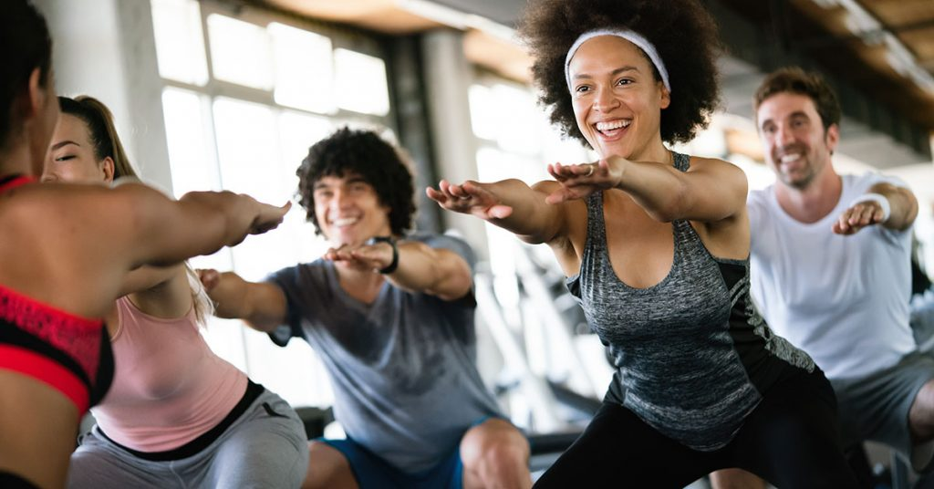 Group of happy fit people at the gym exercising; blog: 10 Heart Healthy Exercises